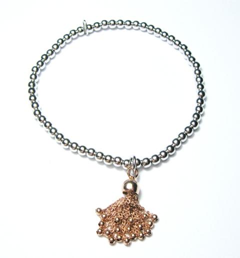 Bracciale in argento sfere elastico con charme dorato pendente